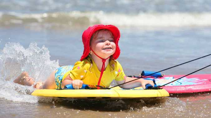 Jada Ryan (3) from Emerald cools off at the beach at Emu Park as even hotter weather is predicted in coming days.