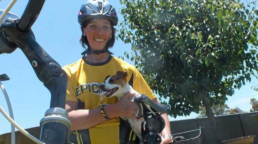 Leanne Cameron – with her training buddy Millie – is preparing to tackle a 200km bike ride to raise money for cancer research.