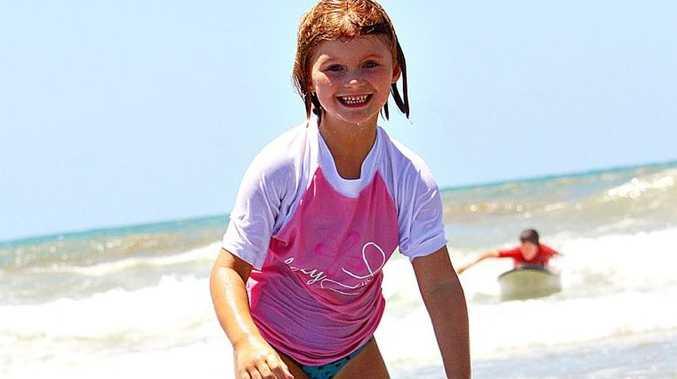 Olivia Smith-Kitto enjoyed her first surf lesson last year. Photo Sophie Jackson / Capricorn Coast Mirror
