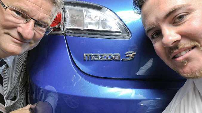 General manager Karl Meir and brand manager Ryan McNall of Lismore Mazda with the Mazda 3 that has become the top selling car in Australia.