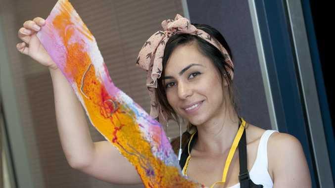 Georgia Mylonas shows off her artwork.