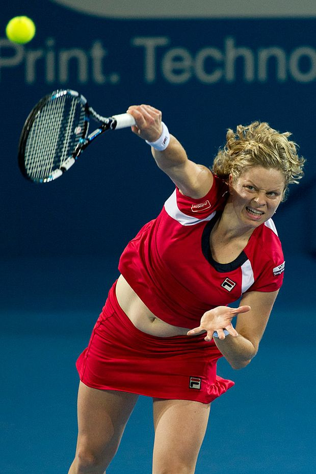 Kim Clijsters serves at the Brisbane International.
