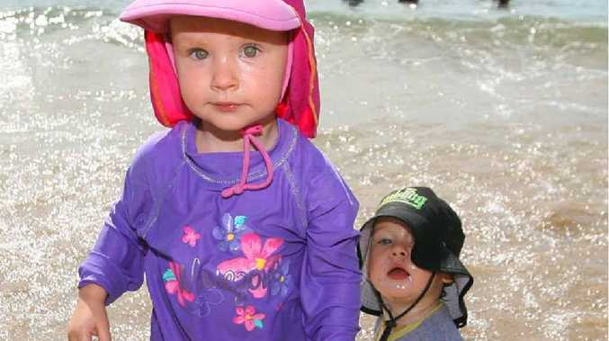 Cousins Mia Nienert (2) and Riley Edwards (20 months) cool off at the beach at Emu Park yesterday. It was Riley's first time at the beach and mum Kirsten said he loved it.