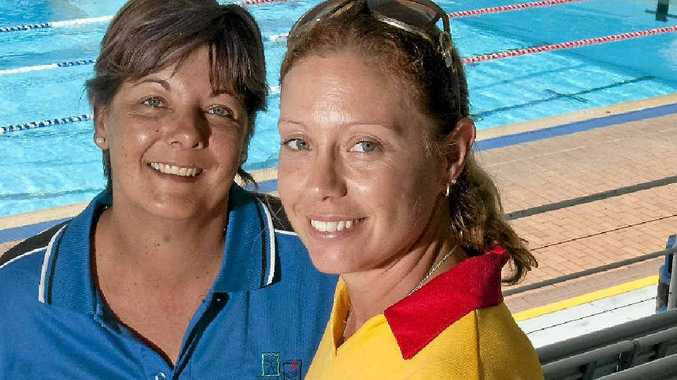 Milne Bay Aquatic Centre Learn to Swim teacher Brooke Van Zeeland (left) and senior lifeguard Brooke Goodair encourage children and adults to act responsibly around water.