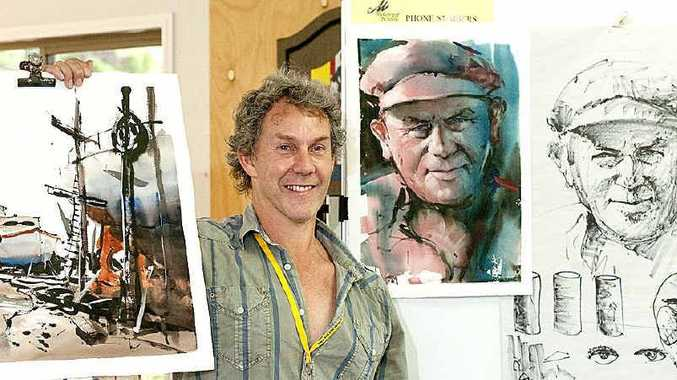 Passionate watercolour teacher Greg Allen shows off some of his completed artworks at the USQ McGregor Summer School.
