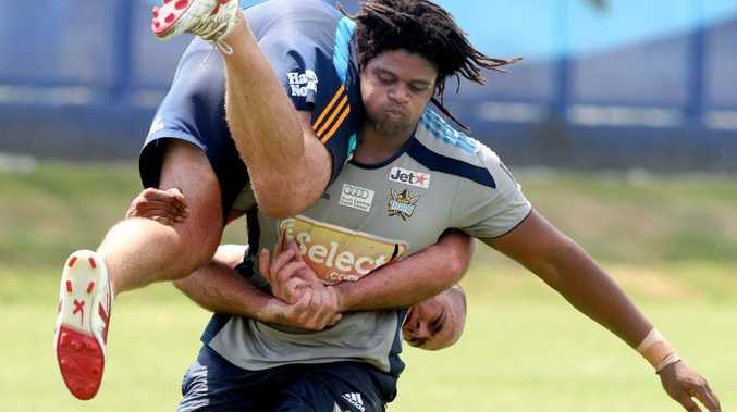 Gold Coast titans train in the heat: Jamal Idris with Matt White.