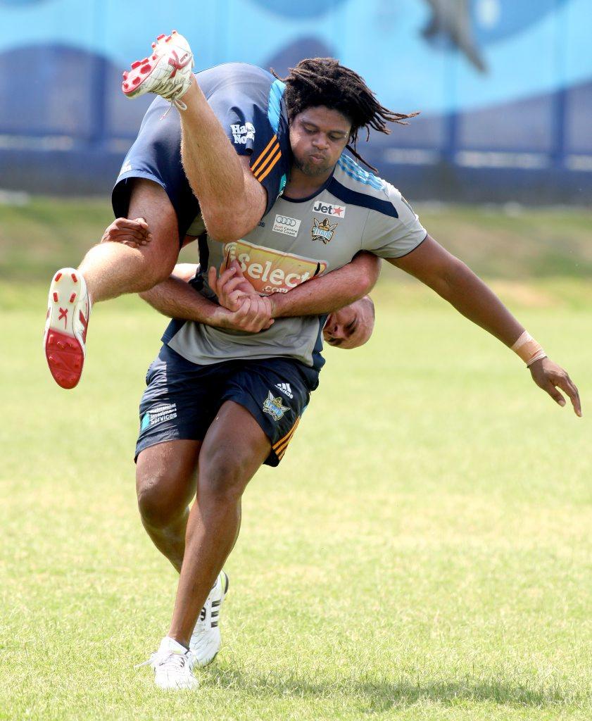 Gold Coast titans train in the heat: Jamal Idris with Matt White.