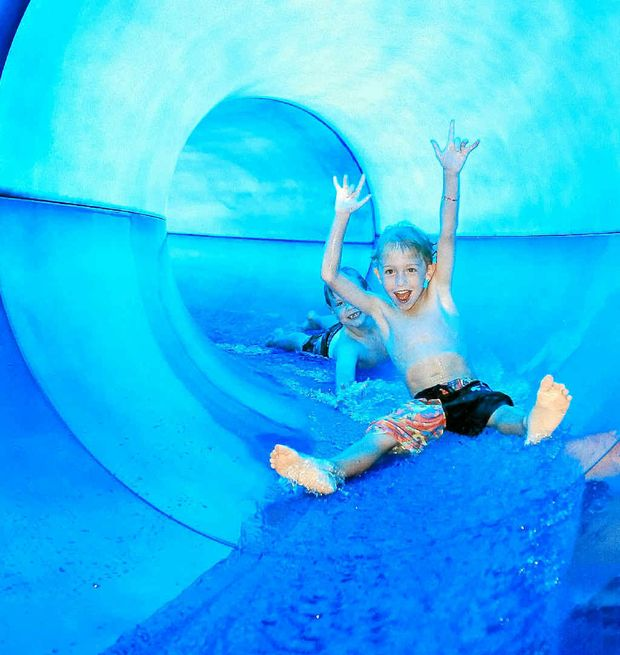 Monty Moore (front) and Will Bates, both 6, cool off on the water slide at the Goonellabah Aquatic centre.