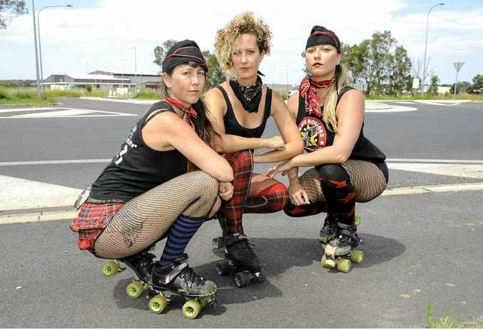 Candy Cracksmacker, Metal Minx and Chook Eye China of the Bay Rollers roller derby team who are struggling to find a home. They are pinning their hopes on the Byron Regional Sports Complex in the background.