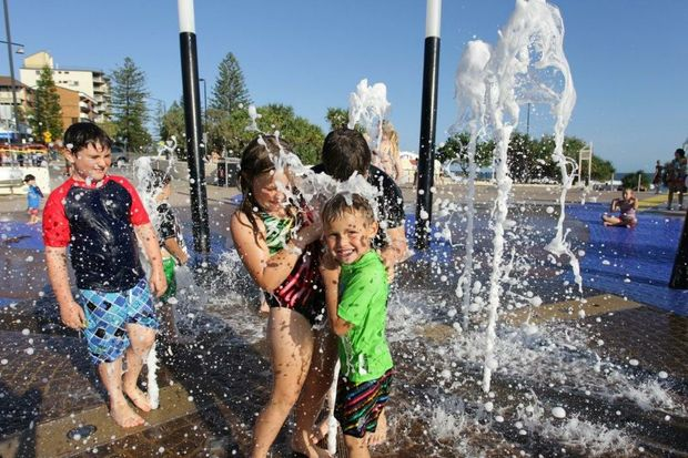 Riley Wilson (10), Brydie Wilson (8) and Kye Wilson (5) all enjoy the water feature at Kings Beach on a holiday from Toowoomba.