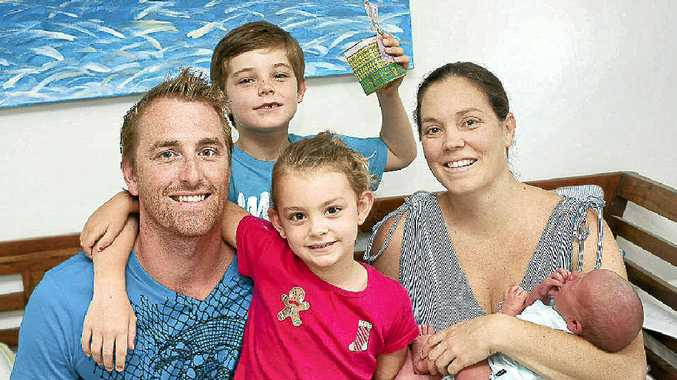 Lee and Hayley Miles with their children Beau, Kya and baby Malachy are saving their money for holidays in the UK.