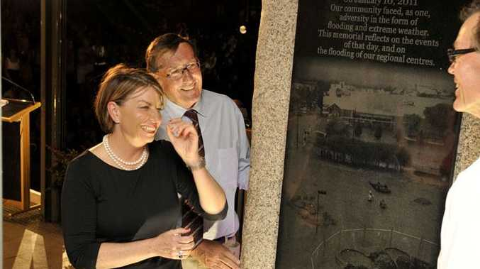 Queensland Premier Anna Bligh unveils the memorial plaque - the