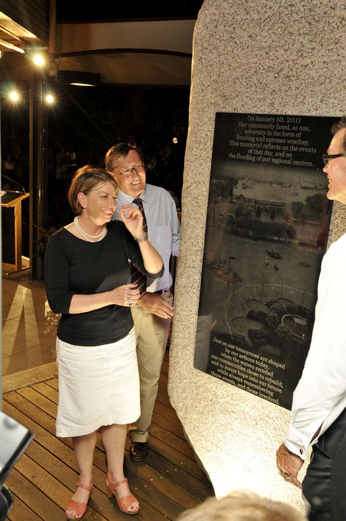 Queensland Premier Anna Bligh unveils the memorial plaque - the