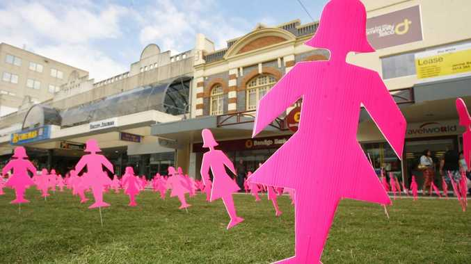 Pink women cut-outs raise awareness of breast cancer and the importance of breast screening.