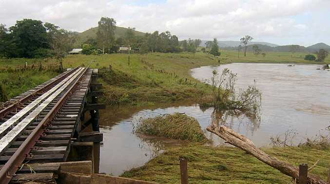 Flood waters recede from the railway line at Woolooga.