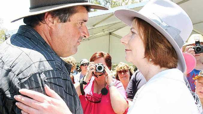 Prime Minister Julia Gillard greets a local at the Gatton commemorative flood service today.