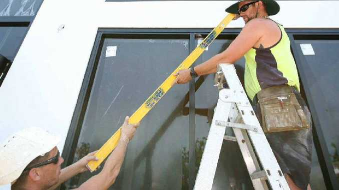 Brett Tobin (left) and Duncan Sinclair, of Endeavour Plastering and Construction, try to work in the shade as much as possible when they're doing outside construction jobs.