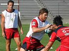 Allora prop Greg Holmes controls the ball at the first Reds training session of the year.