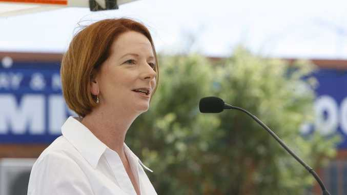 Prime Minister Julia Gillard addresses the gathering at the Goodna 2011 flood commemoration service at Alf Harris Park.