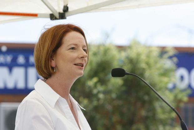 Prime Minister Julia Gillard addresses the gathering at the Goodna 2011 flood commemoration service at Alf Harris Park.