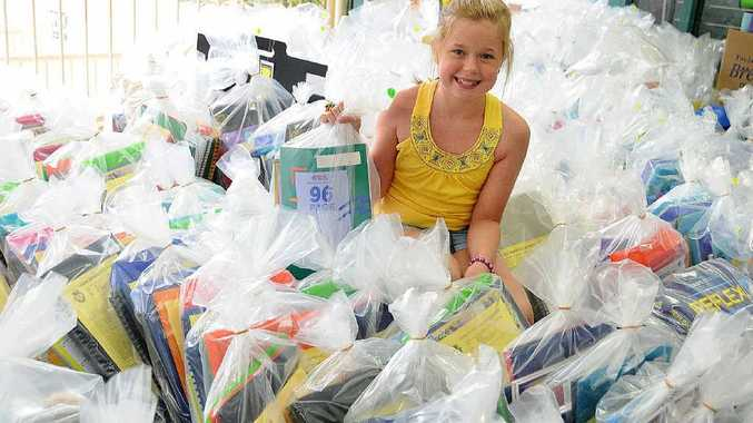 Cooloola Christian College student Olivia Zischke, 10, picks out her back to school order among the many at Gympie News.