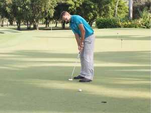 Golfers flagging water hazard