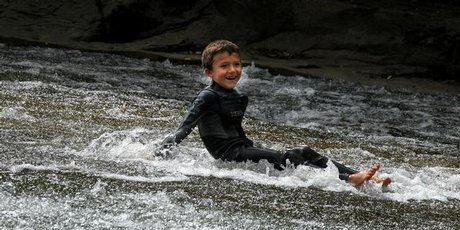 Californian visitor, Levi Gage, tries the rockslide at Rere, west of Gisborne, a little known spot for adrenalin junkies.