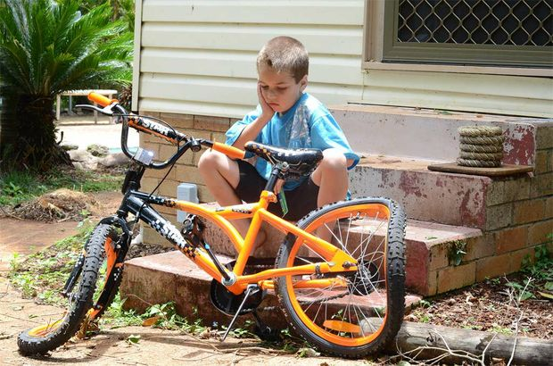 Seven year old Nick Essery of Tregeagle was devastated to discover his new bike that he got for Christmas squashed under a tree that fell in Monday afternoon's storm.