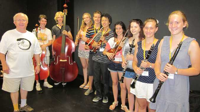 McGregor Summer School co-director of music Shaun Dorney prepares for the grand finale performance with music students (from left) Hugh Hansen, Bryn Keane, Clare Dutton, Johan Kuyler, Tae Young, Mattea Lazarou, Anna Holland, Courtney Cook and Annabelle Thelander.