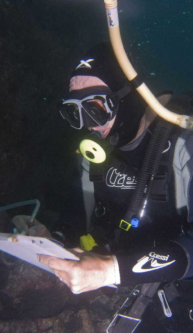 Southern Cross University National Marine Science Centre project officer Bob Edgar collecting data on threatened species.