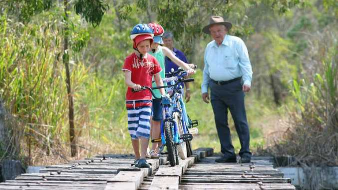 Xavier and Yasmin Graggs along with Bicycle User Group president Jan Boyde and Member for Keppel Paul Hoolihan check out part of the proposed Rail Trail between Rockhampton and Yeppoon.