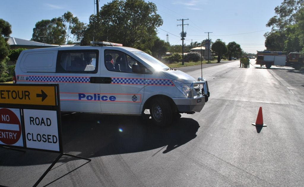 Emergency workers attend the Bowen St scene of the fatal hit and run in Roma on Thursday morning seven hours after the incident