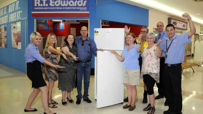 Winners of R T Edwards fridge competition, from left; Casey hollywood - RTEwards consultant, Christine Mischlewski, Joan Dunlop, Robert McAuley, Collee Algate, David Algate, Katrina Langenhorst,Thomas Wiersma (manager R T Edwards) and Aaron Werth R. T, Edwards consultant. Photo:Bev Lacey /The Chronicle
