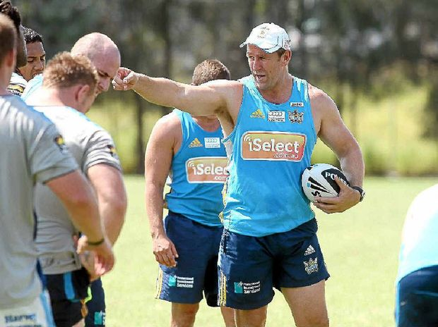 Gold Coast Titans coach John Cartwright issues instructions to his weary troops while they catch their breath during a sun-scorched training run.