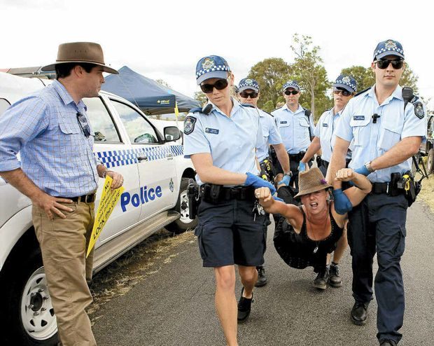 One by one the three protesters are arrested and taken to Beaudesert Police station after they refused to clear the entrance to a exploratory mine site in the Kerry Valley, Scenic Rim Area, Qld.