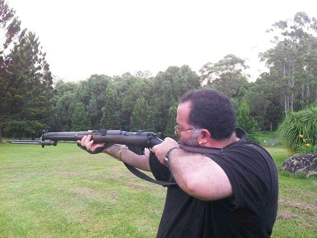 Robert Bou-Hampton, of Lismore, posted a photo of himself with a gun of facebook.