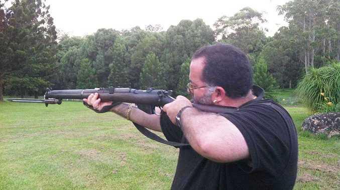 Robert Bou-Hampton, of Lismore, posted a photo of himself with a gun of facebook.