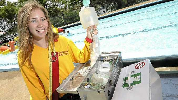 Lifeguard Hannah Negri with some of the CPR and first aid equipment at the Anzac Pool.