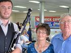 Scottish piper Andy Matthews with Carolyn and Jim Pierce at the Travelling Country Music Association social.