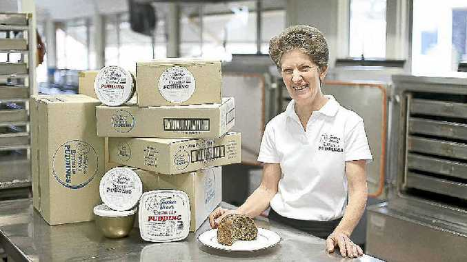 Mrs Bev Crethar, manager of Father Mac's Heavenly Puddings, with boxes ready to be shipped out.
