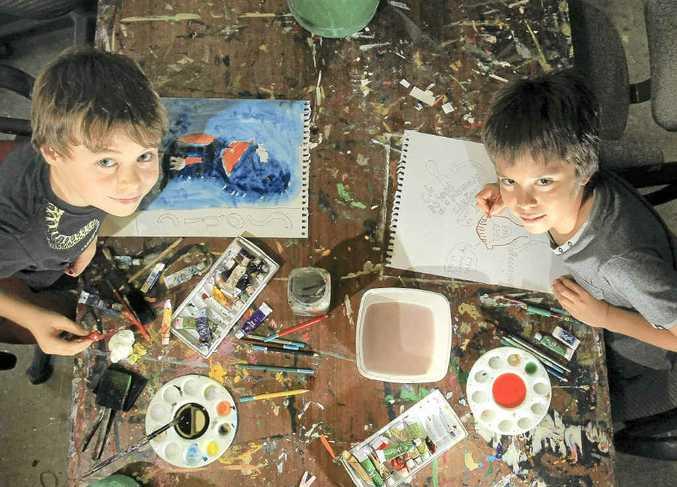 Young artists David Elliott (left) and Jared Duckworth get stuck into art at an Art Lab class.