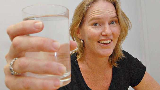 Mackay Alcohol, Tobacco and other Drugs (ATODS) prevention co-ordinator Christine Low uses water to toast the Hello Sunday Morning program, which encourages people to give up alcohol for three months.