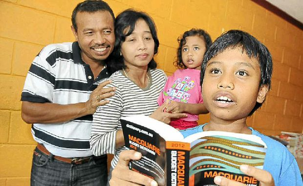 Boyd Mbato, 9, of East Lismore spells for his proud Mum Purwati Anjar Whayuni and Dad Con Laus Mbato and little sister Vanessa Koza Loas.