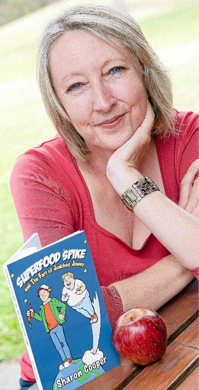 Sharon Cooper and her new book, featuring Superfood Spike and Junkfood Jimmy.