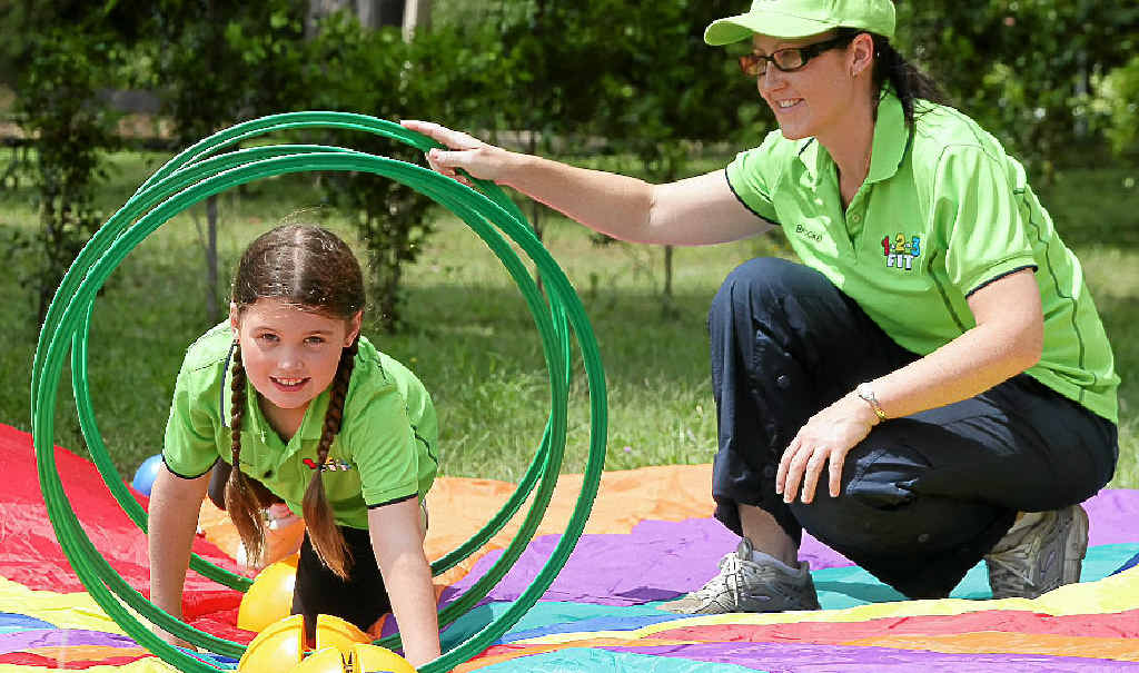 Brooke Coulstock coaches her daughter Pru in the fun fitness program, 123FIT, developed for kids.