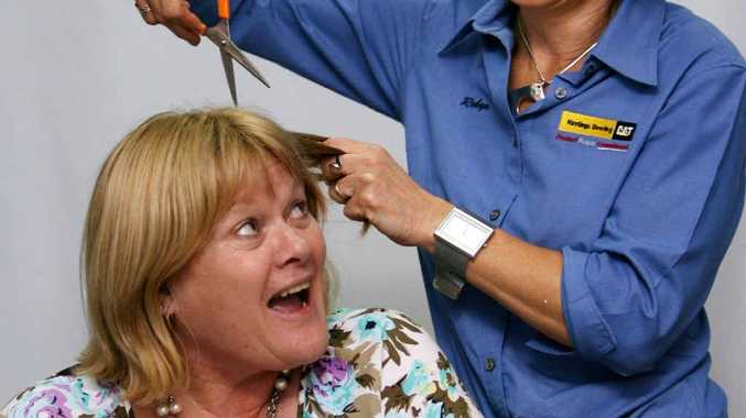 Rockhampton's Sue Bridgeman is ready to lose her locks with the help of family friend Robyn Dilley.