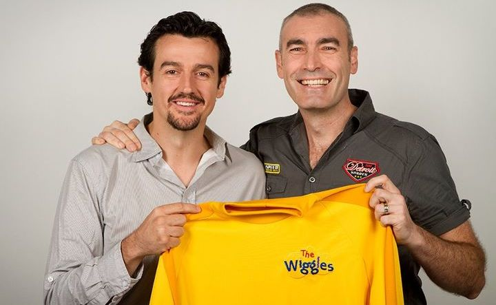 Sam Moran hands the iconic shirt back to Greg Page, the original Yellow Wiggle.