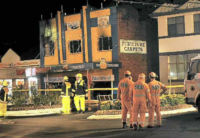 Emergency workers at the scene on Wednesday night outside the MacDade and Family store in Summerland Way, Kyogle.