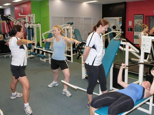 Femnasium Health Fitness Boutique owner Robyn Agius (left) demonstrates pilates to Sonja Hallam, while Palmira Brooks (centre) takes Rachel Euler through some weight training exercises. Trainer Hannah Robinson (at rear) checks on Angela Menck and Hayley Bryant on the treadmills.