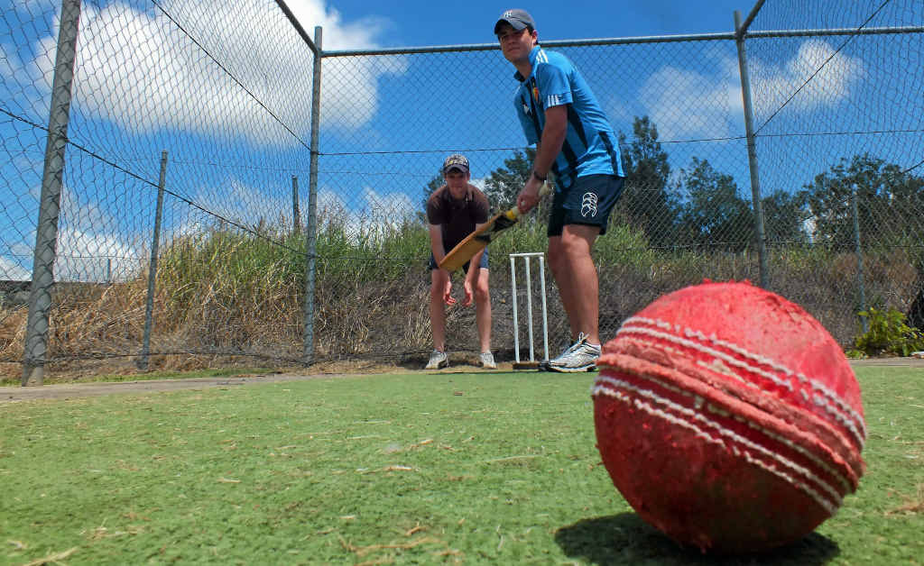 Past Scots PGC students Guy Uebergang (back) and Patrick Slattery hit a few balls ahead of this weekend's Australia Day cricket match.